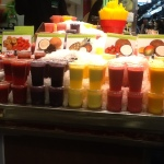 Fresh-squeezed juices lined up at a stall in La Boqueria.