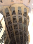 I'm standing on the roof of Gaudi's La Pedrera building photographing into the courtyard below. These are the windows of the apartments across from where I'm standing.