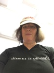 """Act justly, walk humbly"" on my hat, and wearing my ACLU t-shirt, ""Dissent is patriotic."""