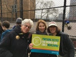 Judy Stern, her friend Joanne, and me with AJWS sign